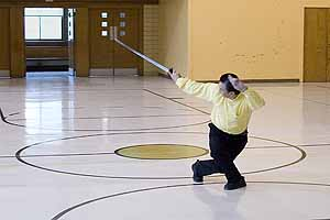 Grandmaster demonstrates a Tai Chi sword form